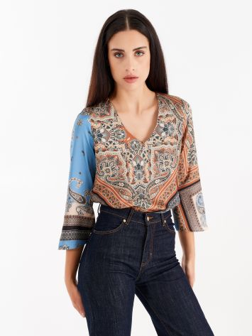Asymmetrical blouse with patch print Asymmetrical blouse with patch print Rinascimento