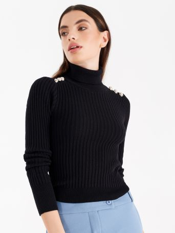 Knit turtleneck, cable-knit workmanship with sailor inspired buttons