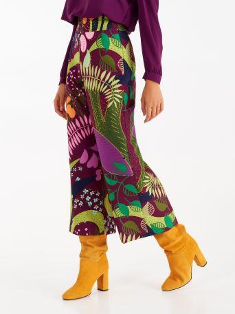 Pantalon court imprimé botanique dans les tons vert et violet