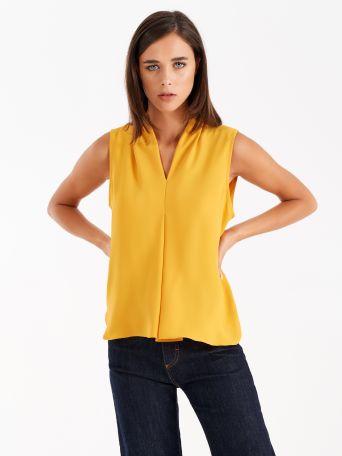 Top de color amarillo mostaza
