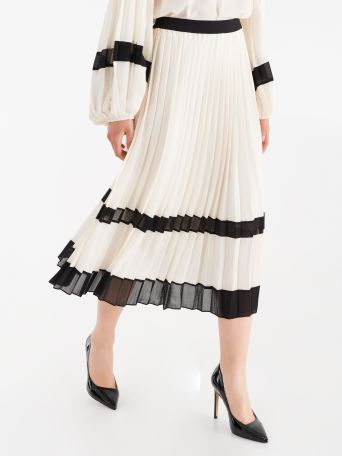 Pleated skirt with contrasting inserts