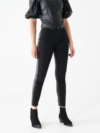 Skinny jeans with faux leather inserts